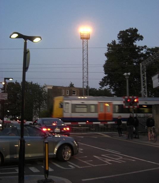 Picture of level crossing outside Acton Central Overground station