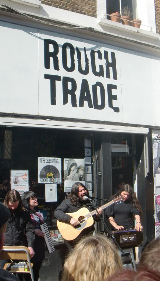 Picture Rough Trade with Magic Numbers playing in front of shop