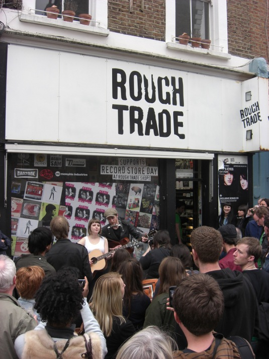 Picture of Trevor Moss and Hannah-Lou playing in front of shop