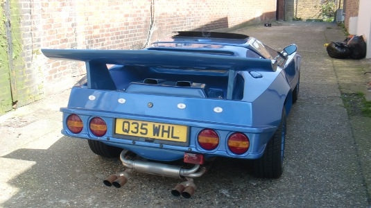 Picture of rear of blue sports car