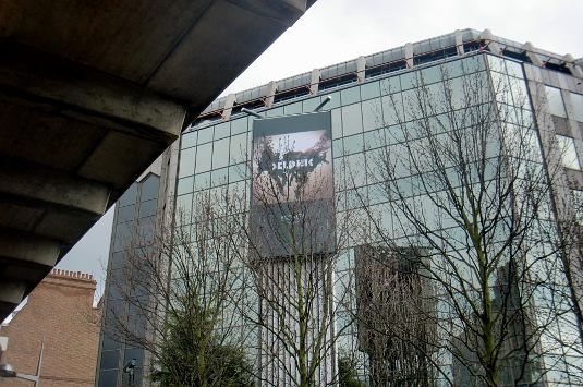 Picture of Delphic poster next to Hammersmith flyover