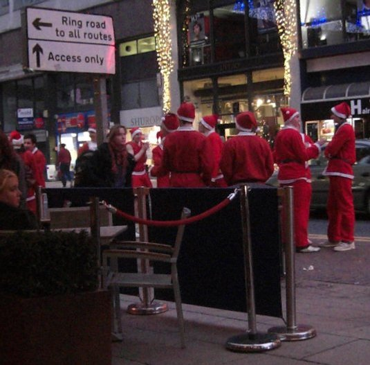 Picture of Santas loitoring in Deansgate, Manchester